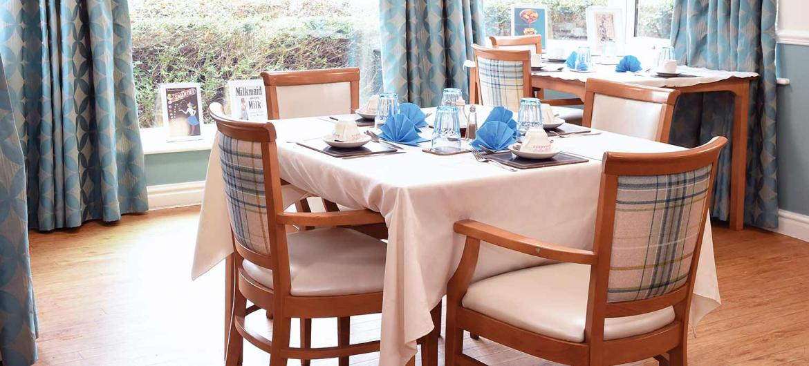 A dining table set for residents in the restaurant.