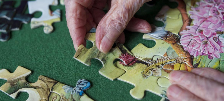 A resident enjoys doing a jigsaw.