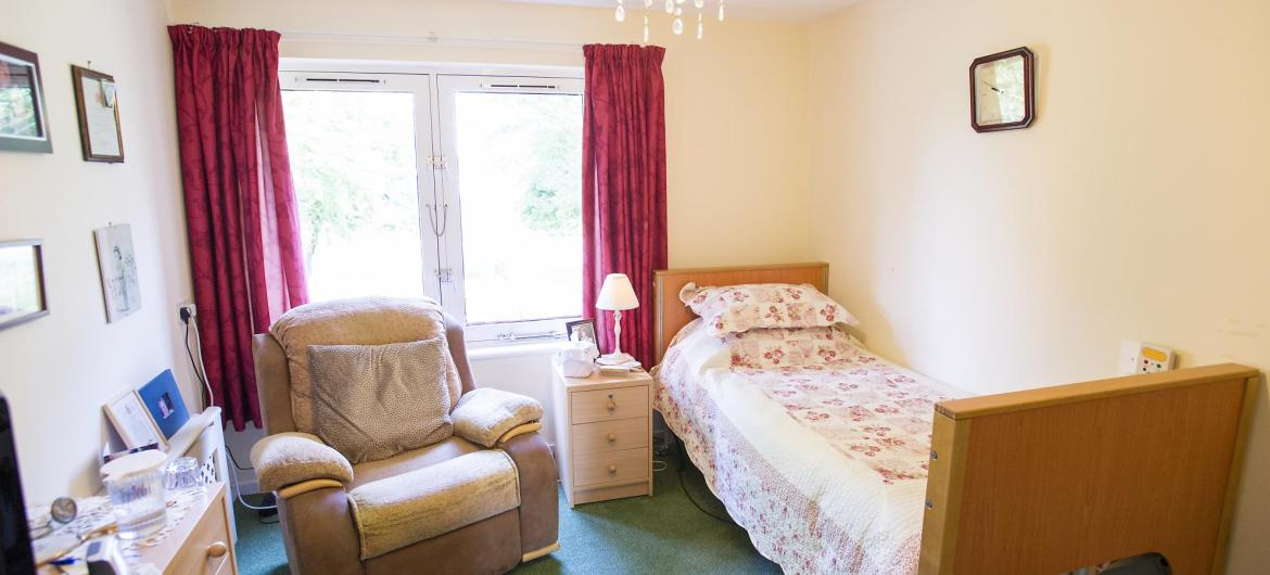 A light and airy bedroom at the Don Thomson House Residential Care Home.