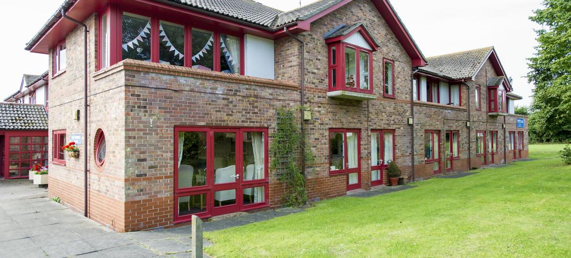 The view of the brick Don Thomson Care Home across the lawns.