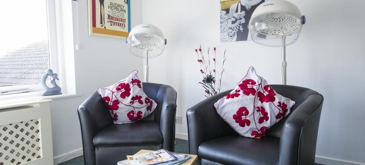 Leather sofas and hair dryers in the Don Thomson Care Home hair dressing salon.