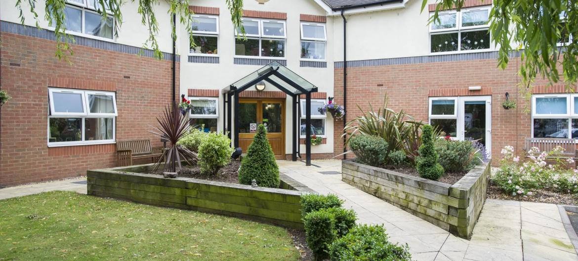 The manicured front garden and entrance to East Park Court Residential Care Home.