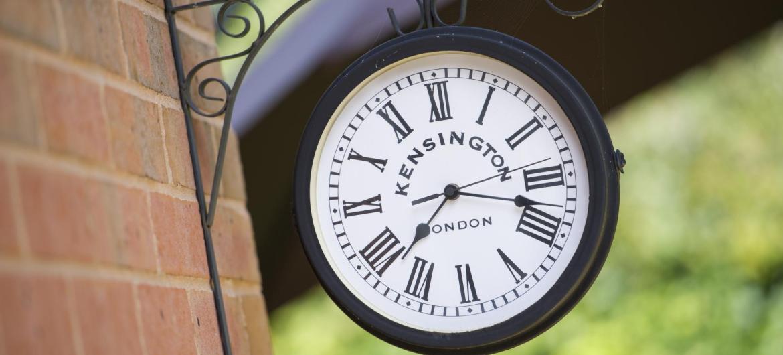 A wall clock in the garden.