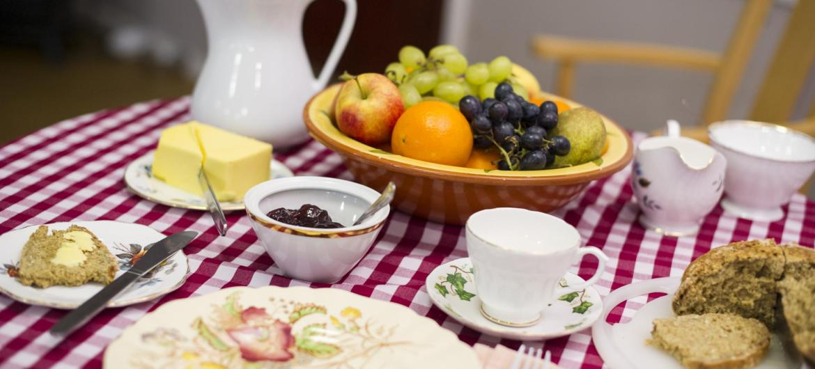 A table set for breakfast with fruit, toast and butter at Forest Dene Residential Care Home.
