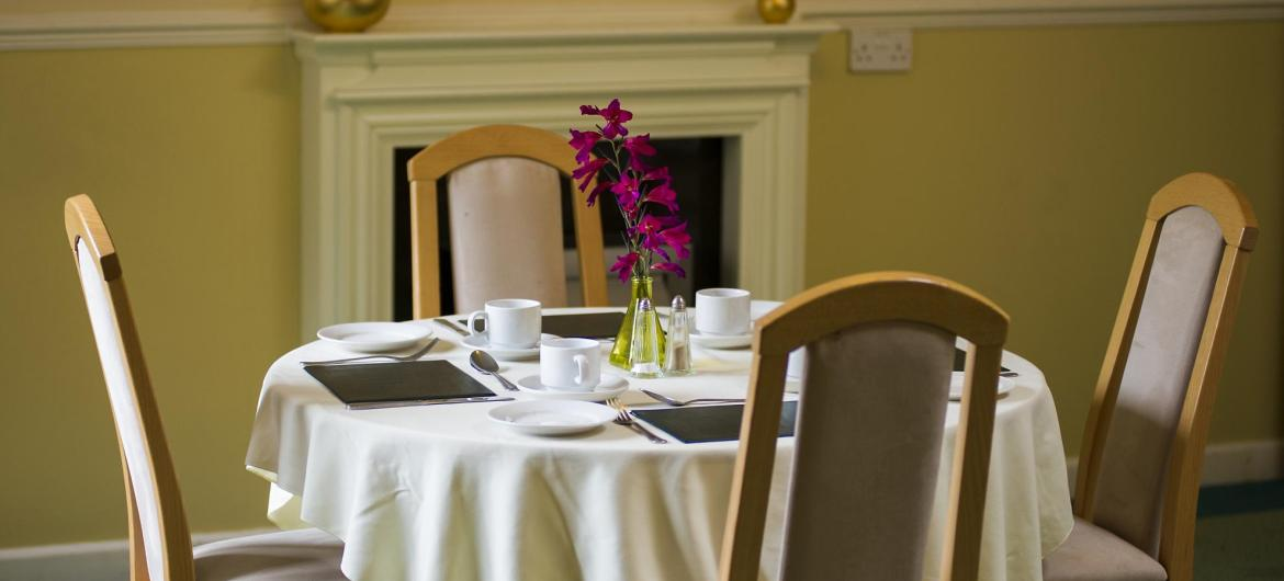 The beautifully set dining room tables at Furzehatt Care Home.