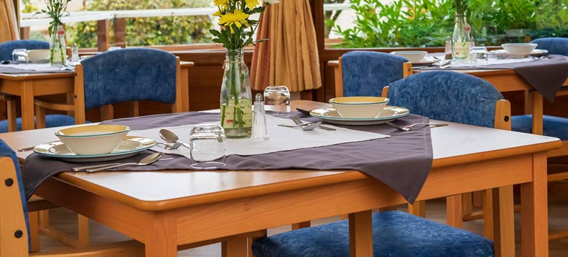Spacious dining room areas offering lovely garden views at Mull Hall Care Home in Invergordon