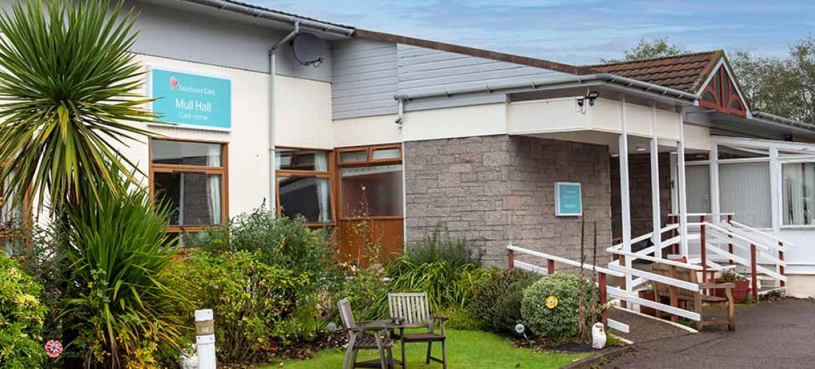 Exterior with outdoor seating area at Mull Hall Care Home in Invergordon