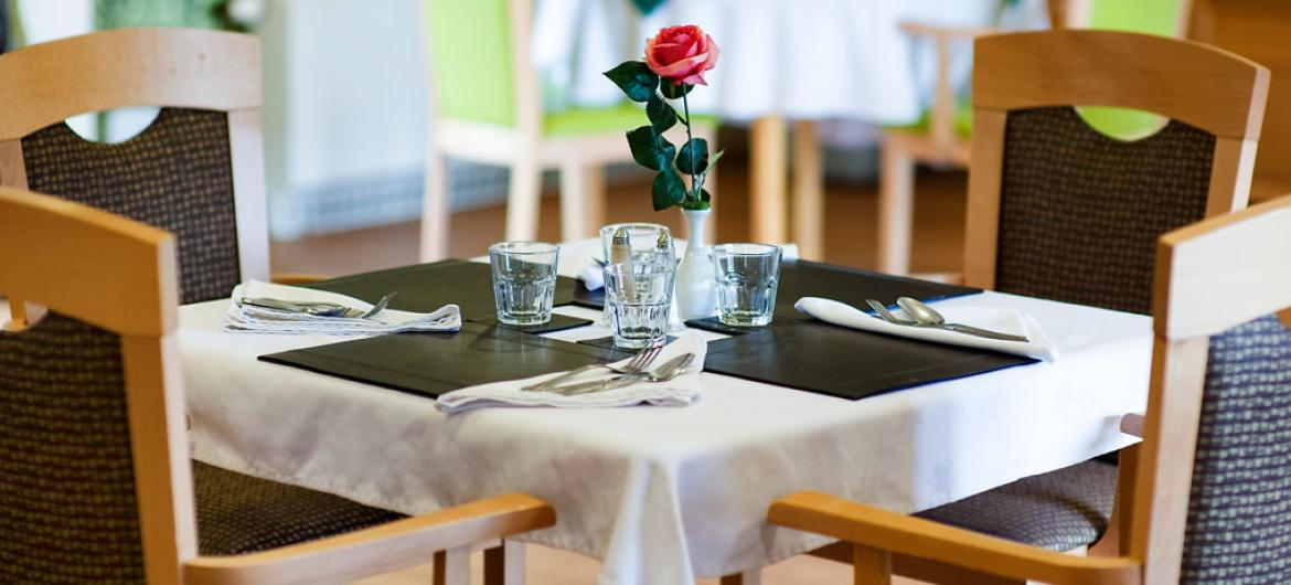Places set for dinner service in the care home restaurant.