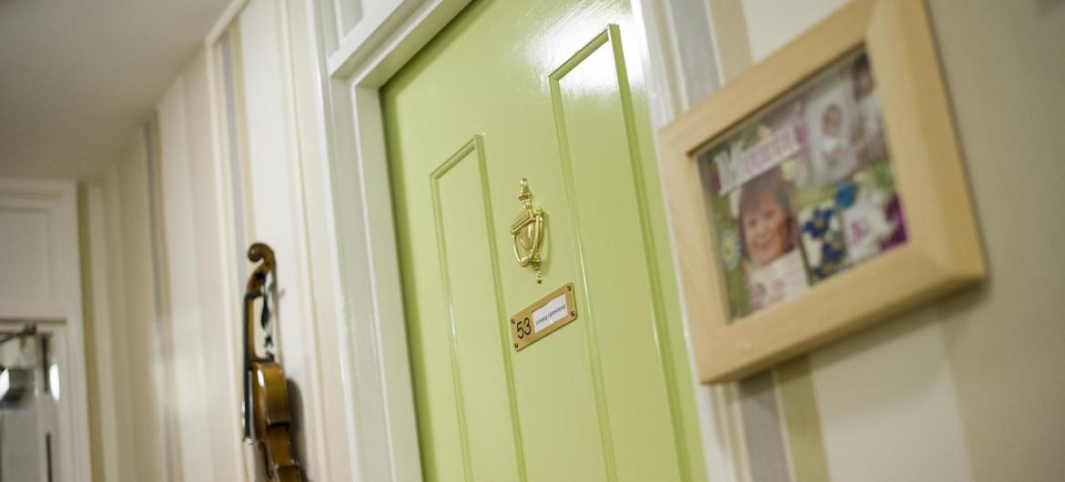 The green front door of a residents room at the Westmead Residential Care Home.