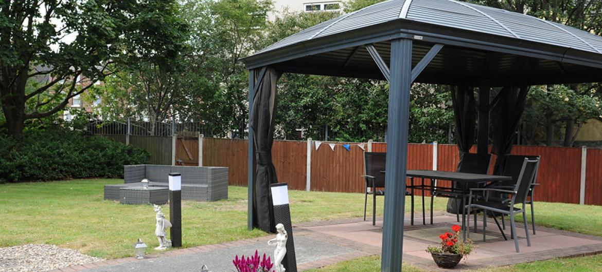 Outdoor seating area at Willow Gardens Residential and Nursing Home in Merseyside