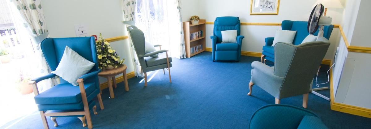 The blue chairs, curtains and carpets blue lounge in the Wantage Nursing Home.
