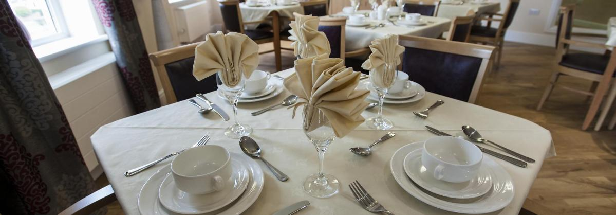 The dining tables at Lime Tree Court Residential Care Home set for dinner.