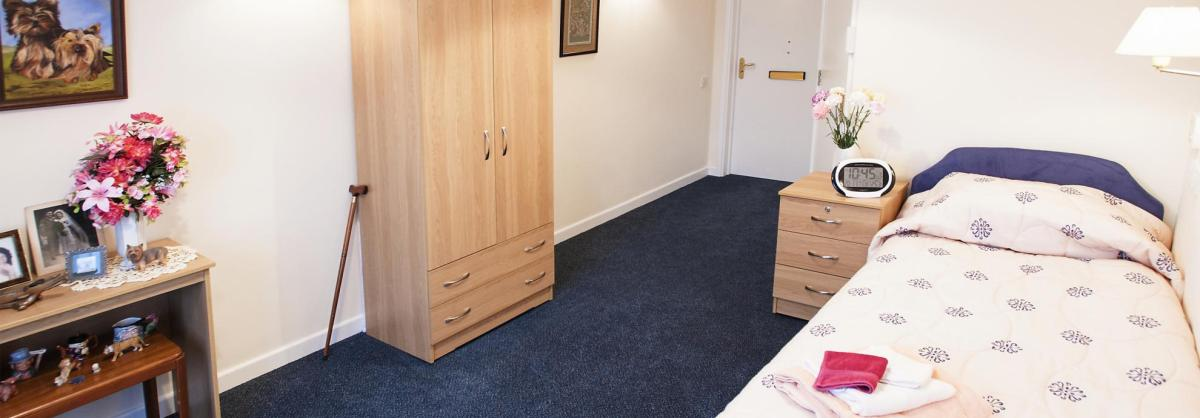 A cosy bedroom in the Regent Residential Care Home.