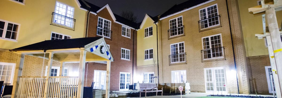 The front entrance of the Iffley Residential and Nursing Home beautifully lit up a night.