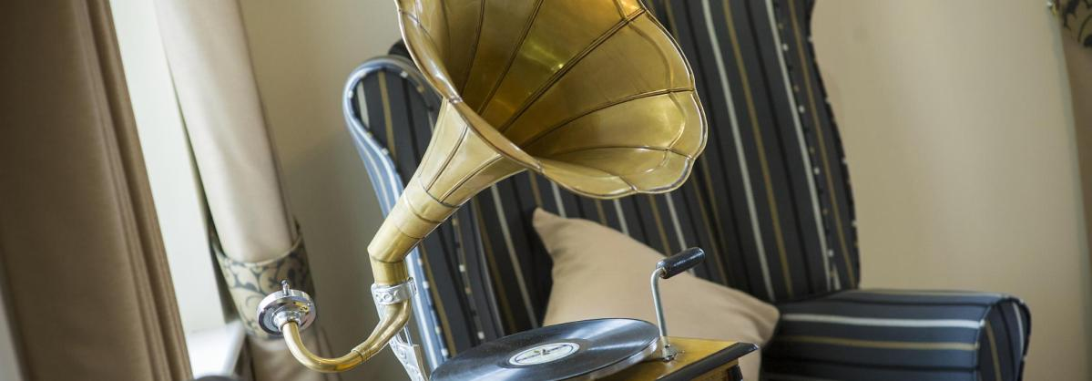 A black and gold traditional gramophone.