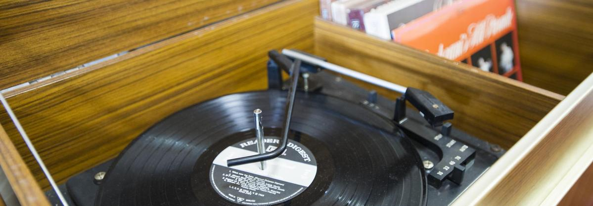 A record player and records in the activity station.