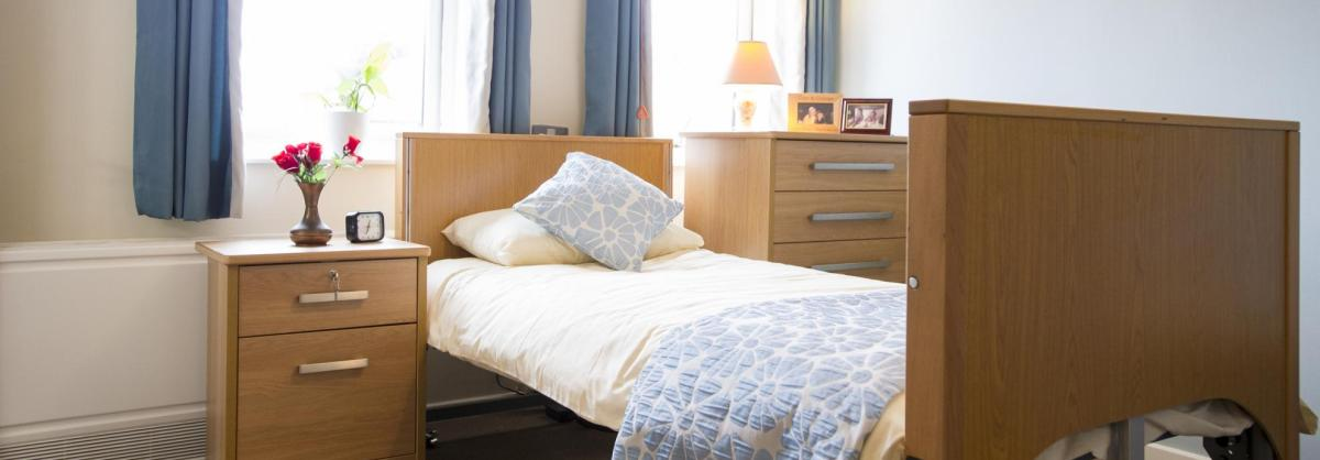 A bright and airy bedroom at Shaftesbury Court Residential Care Home.