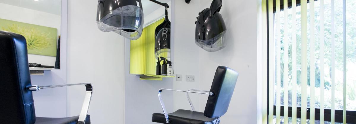 A black and lime green, modern hair dressing salon at the Parkview House Residential Care Home.