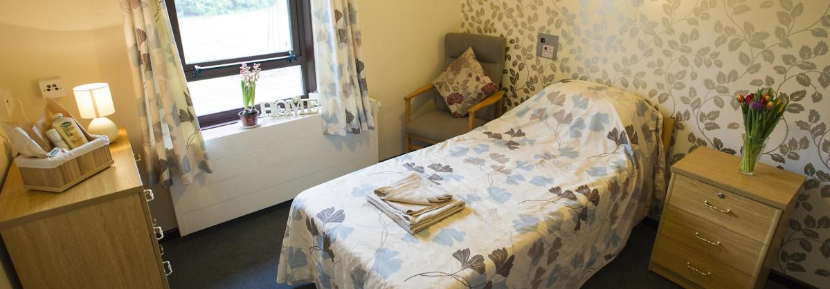 A bedroom at Beechwood Residential Care Home.