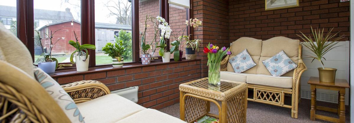 The conservatory at Beechwood Residential Care Home.