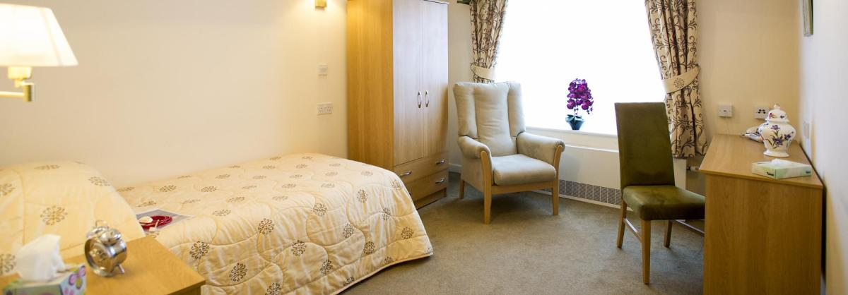 A country-style bedroom at Brambles Residential Care Home.
