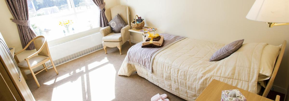 A light and airy bedroom at Breme Residential Care Home.
