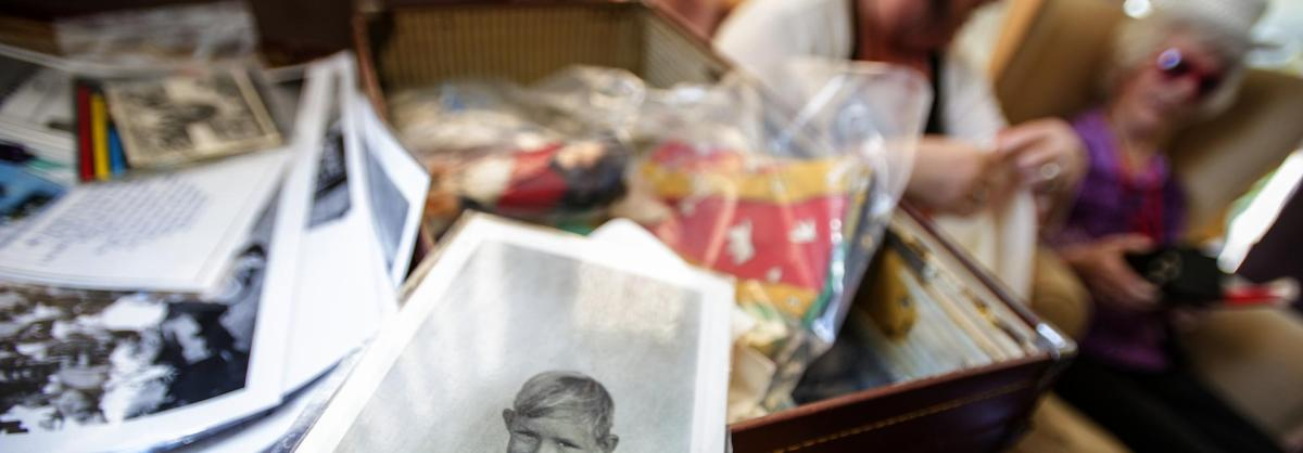 A reminiscence box with old photographs and memorabilia.