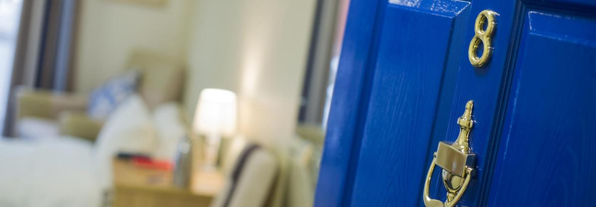 A blue front door to one of the bedrooms at Haven Residential Care Home.