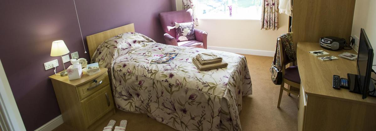 A pretty bedroom at Lake View Residential Care Home.