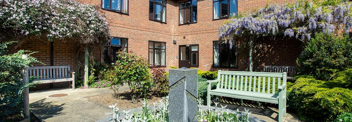 Outdoor seating in the gardens at Dalby Court Residential Care Home in Middlesbrough
