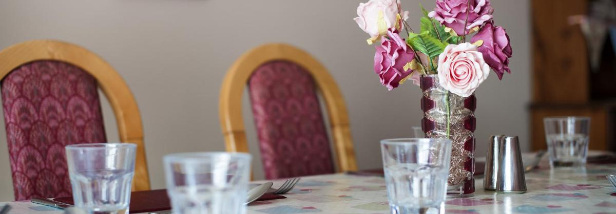 Flowers on the dining room table at Don Thomson House Residential Care Home.