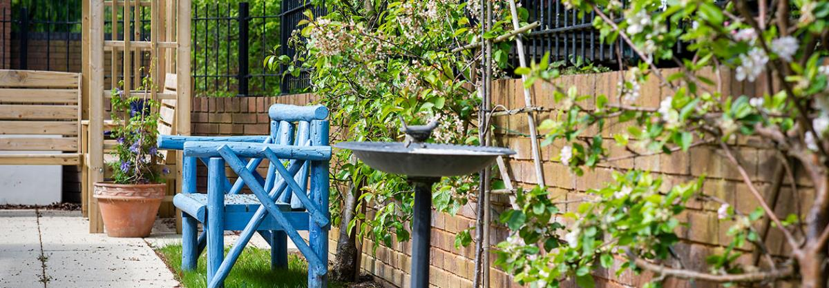 Outside bench and bird bath at Dovecote Residential and Nursing Home in Durham
