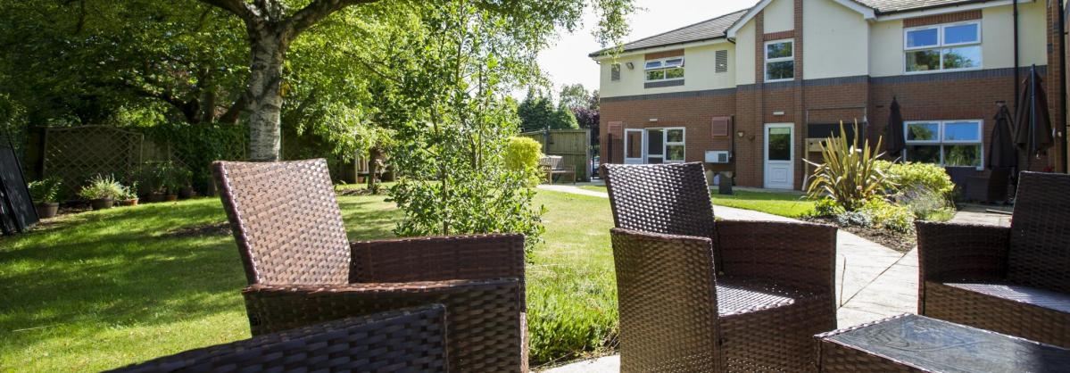 Wicker chairs in the gardens at East Park Court Residential Care Home.