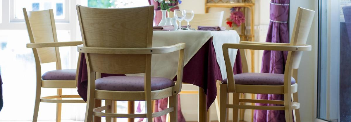 The light and airy dining room with floor to ceiling windows at the Fernihurst Nursing Home.