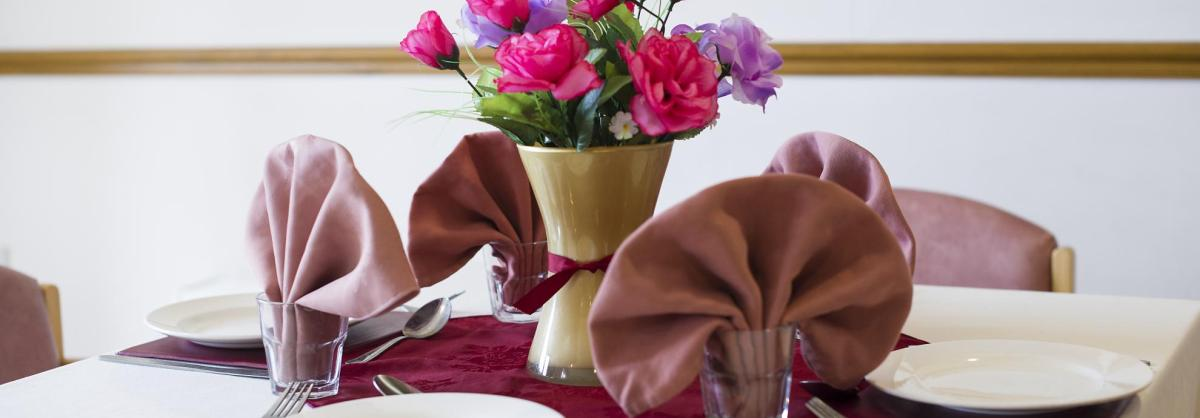 Flowers and napkins on the dining table at Hatfield Residential and Nursing Home.