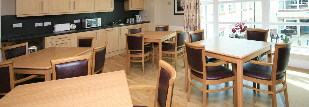 The dining room at Park View Residential Care Home has an open plan kitchen area.