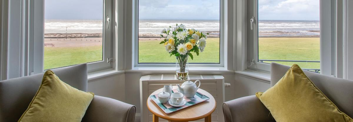 Queens care home lounge with a sea view