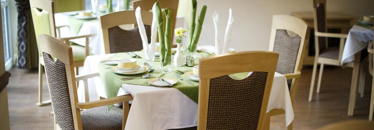 The dining room with wooden floor and chairs at Yarnton Residential and Nursing Home.