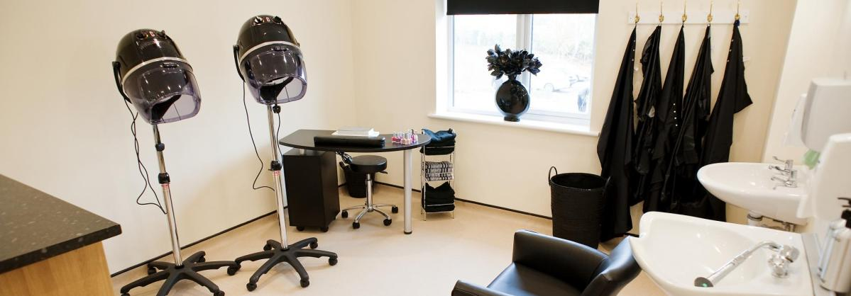 The contemporary black and white hairdressing salon at Yarnton Residential and Nursing Home.
