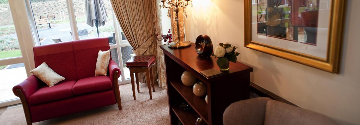 The traditionally styled lounge at Yarnton Residential and Nursing Home has curtains with beautiful swags and tails.