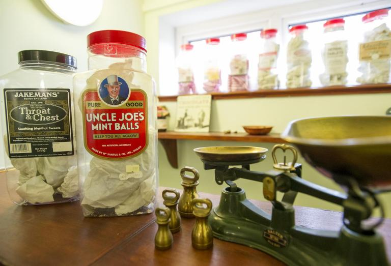 An old sweet shop with jars of sweets and weighing scales.
