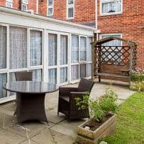 Birchwood Residential Care Home patio and gardens.
