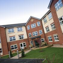 The front gardens and entrance to Highcroft Hall Residential Care Home.