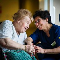 A Sanctuary Care nurse talks with a resident.