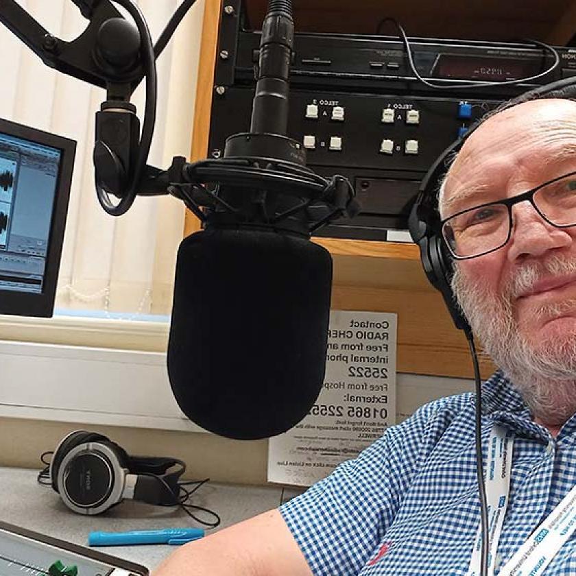 John Lant sitting in the studio wearing a headset
