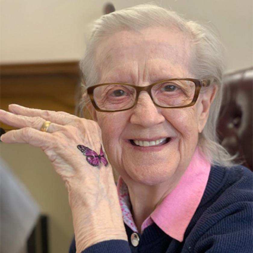 Kintyre House resident shows off a temporary butterfly tattoo on their back of their hand
