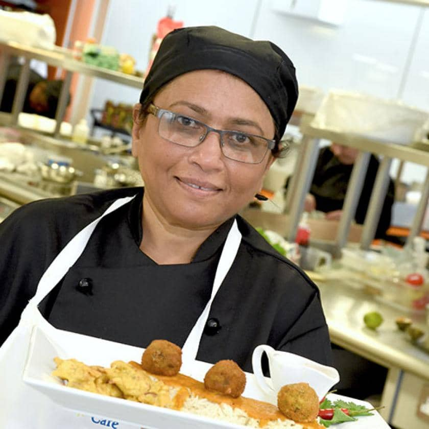 Aashna House chef with one of her dishes