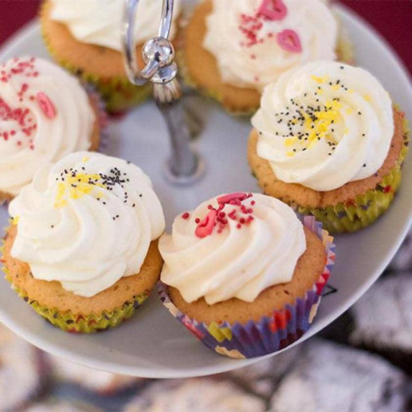 Decorated cupcakes on stand