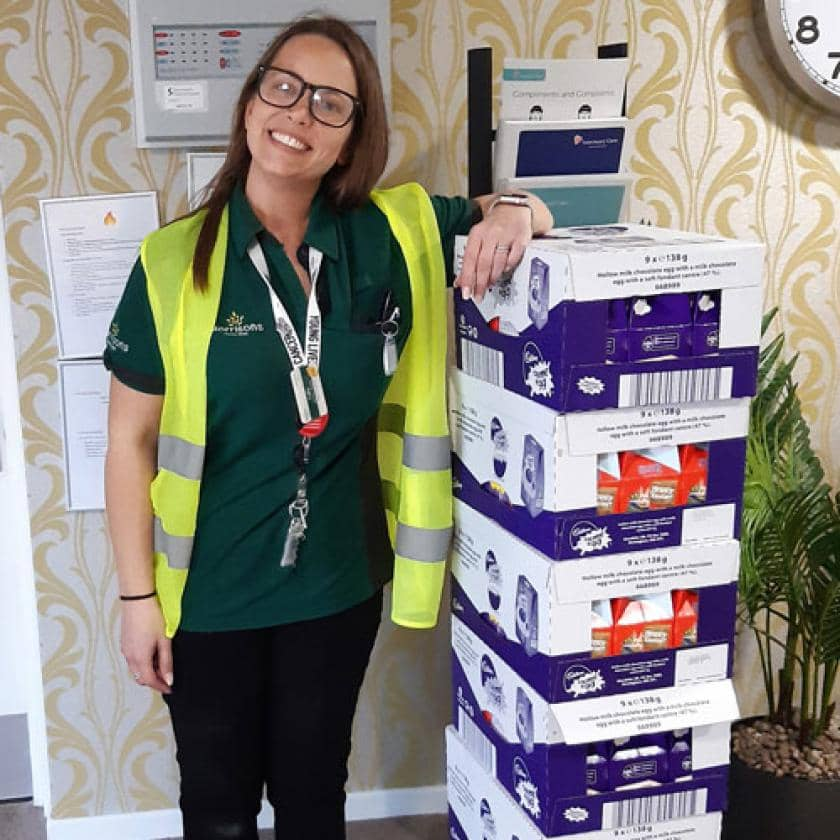 A Morrisons staff member delivering easter eggs to Don Thomson.