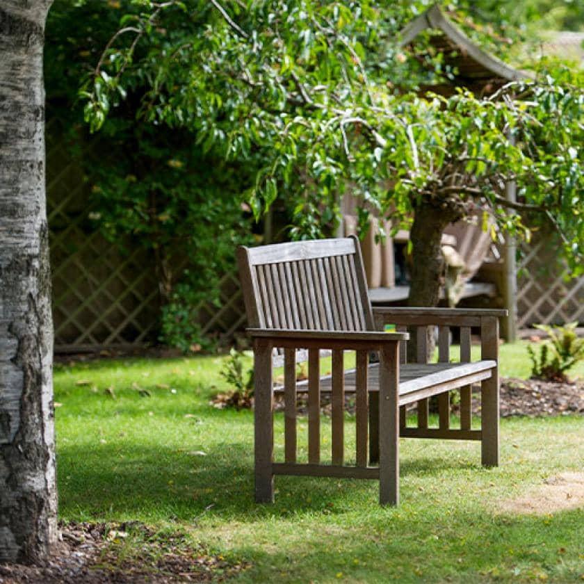 East Park Court outdoor bench in the garden